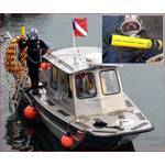 WJ Castle diver preparing to enter the water and track a cable with JW Fishers CT-1 cable tracker; Inset photo – Castle diver in water with CT-1 probe.