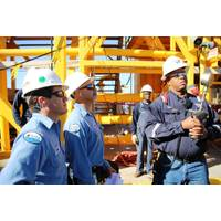 BSEE inspectors monitor a pressure gauge held by an oil worker during a pressure test of temporary equipment on a deepwater facility in the Gulf of Mexico (Photo: BSEE)
