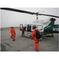 Coast Guard R&D Center researchers board a helicopter as they prepare to evaluate remote Alaskan sites to establish a communications relay network. (U.S. Coast Guard photo by Coast Guard Research & Development Center staff)