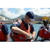 Coast Guard National Strike Force samples water in Honolulu Harbor
