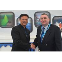 David Currie, MD of Seatronics (left) and Martyn Grange, sales manager of Teledyne TSS confirm the sale at Ocean Business.  (Credit: Teledyne)