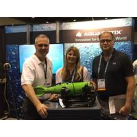"At the DEMA Show 2017 (L-R):  Aquabotix Chief Development Officer Ted Curley; Audrey Darley, Director of Vendor Relations for Darley; and Henry ""Ace"" Thrift, Director of Business Development, Navy/SOCUM/Federal Team. (Photo: Aquabotix)"