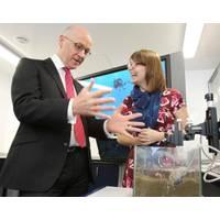 The Deputy First Minister with Dr Heidi Burdett at the Lyell Center's aquarium laboratory. (Photo: Heriot-Watt University)