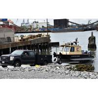 A District vehicle retrieves a survey vessel at the New York District's reconstructed Caven Point Marine Terminal in Jersey City, N.J., June 12, 2018. The new boat ramp enables launching and retrieving craft during all points in the tide cycle. A section of the Hydrogaphic Surveys class was taught aboard survey vessels on the water in New York-New Jersey Harbor. (Photo by James D'Ambrosio)