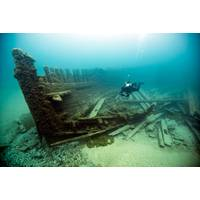A diver surveys the wreck of Lucinda Van Valkenburg, a wooden three-masted schooner that sank just north of Middle Island in 1887. (Photo: Tane Casserley/NOAA)