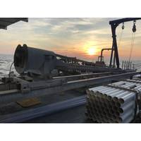 Figure 1: With the sun rising over the horizon, the coring rig sits ready for deployment. Image courtesy of A. Herre-ra- Schneider.