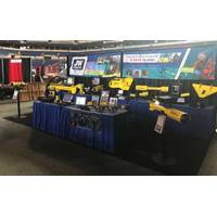 JW Fishers set up shop in a booth in the Lucas Oil Stadium and brought its entire product line to display, demo and discuss. (Photo: JW Fishers)