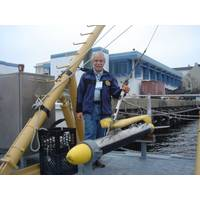 "Martin Klein with a Klein  multibeam side scan sonar. ""We were proud that side scan was able to finally replace the old wire drag technology."" (courtesy Martin Klein and the MIT Museum)"