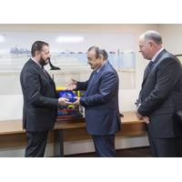 A plaque is presented by Massimo Brebbia, Fugro Subsea MD, to Samir Al Gharbi, GASOS General Manager, with Chris Blake, Director FSME (Photo: Fugro)