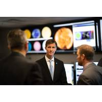 Retired Navy Rear Admiral and Deputy NOAA administrator Tim Gallaudet meets with scientists at NOAA's National Weather Service Space Weather Prediction Center in 2018 in Boulder, Colorado. Credit: NOAA
