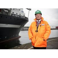 Roddy James, Director of Stork Technical Services Subsea, with the company's chartered Olympic Triton vessel.