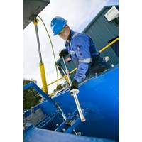 ROMAR employee working on a swarf handling unit