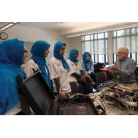 Side scan sonar inventor and long-time MATE competition judge and supporter Marty Klein speaks to the all-female ROV team from Saudi Arabia during the 2017 international event. Photo courtesy MATE II
