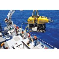 "URI students, technicians and scientists launch the remotely operated vehicle  ""Hercules"" into the Black Sea to study the geology of the seafloor."