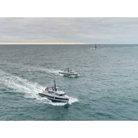 """""""Two Thales unmanned surface vessels are pictured entering Plymouth Sound for the first time.""""  Photo credit: Shaun Roster Photography"""