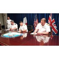 Vice Adm. Louis-Michel Guillaume, left, commander of French Submarine and Strategic Oceanic Forces, Vice Adm. Kevin M. Donegan, middle, commander of the U.S. Naval Forces Central Command, and Rear Adm. Robert K. Tarrant, commander Operations of the Royal Navy, sign an agreement to increase coordination for anti-submarine warfare activities between France, the U.S. and the United Kingdom.  Photo: United States Navy