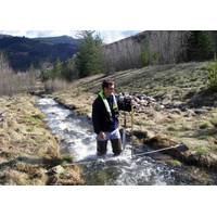 What:Hydrologist Measuring Streamflow When:4/11/2014 Where: Smelterville, ID, USA  Details:USGS hydrologist Greg Clark measures streamflow on Government Gulch Creek, a tributarty to the Coeur d'Alene River in northern Idaho. Streamflow data collected are included in the Coeur d'Alene Basin Environmental Monitoring Program the USGS conducts in cooperation with the Environmental Protection Agency.  Credit: U.S. Geological Survey  Department of the Interior/USGS U.S. Geological Survey/photo: De