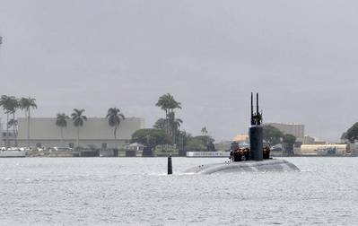 The Los Angeles-class fast attack submarine USS Santa Fe (SSN 763) departs Joint Base Pearl Harbor-Hickam for a deployment to the western Pacific. (U.S Navy photo by Mass Communication Specialist 2nd Class Steven Khor/Released)
