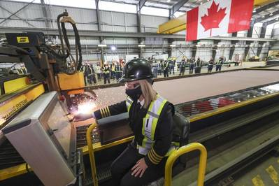 The Canadian Coast Guard's Heather McDonald cuts the first steel at Seaspan's Vancouver Shipyard, marking the start of construction of Canada's most modern science research ship. (Photo: Seaspan Shipyards)