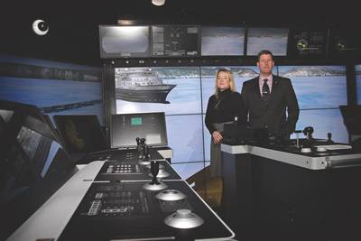 (R-L) Captain Chris Hearn, Director, Center for Marine Simulation and Maria Halfyard, Manager, Applied Research and Industrial Projects  in the Offshore Operations Simulator which is outfitted with a DP system (controller is on the left) (Photo: National Research Council of Canada)