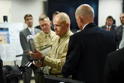 Commandant of the Marine Corps, Gen. Robert B. Neller, is briefed on the Advanced Capability Extended Range Mortar (ACERM) during an Office of Naval Research (ONR) awareness day. (U.S. Navy photo by John F. Williams)