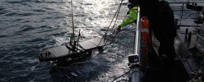 The crew of Icelandic Coast Guard survey vessel Baldur deploys a Wave Glider for measuring winds, February 22, 2017 (Photo: Scripps Institution of Oceanography)