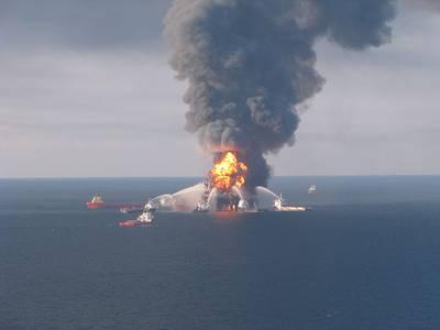 Deepwater Horizon burning in April 2010. Image by US Coast Guard