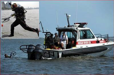 Indian River Fire Rescue diver surfaces holding 16 inch coil after recovering evidence. Inset photo: Randive diver jumps in with Pulse 8X metal detector.