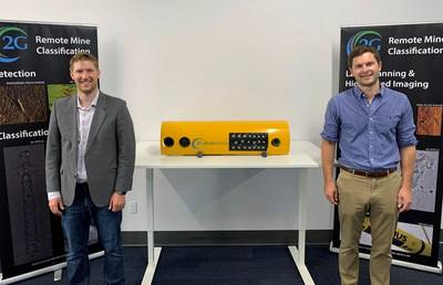 Jason Gillham (left) and Chris Gilson with one of 2G Robotic's latest RECON line of payloads for light, modular AUVs.