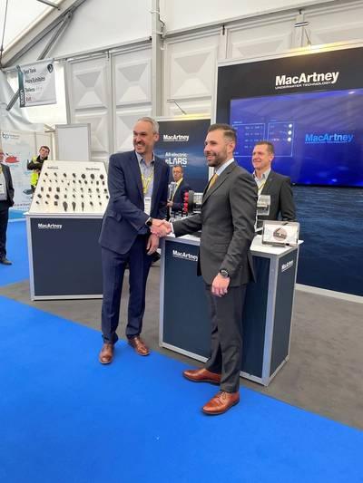 MacArtney's Phil Middleton and STR's Neil Jackson confirm the NEXUS 8 transaction at OB21. Photo courtesy MacArtney