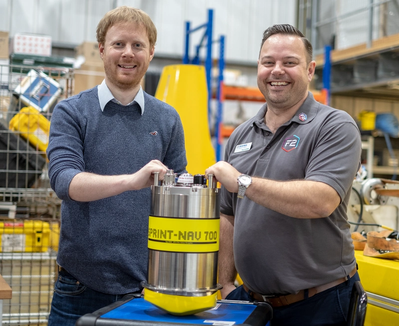 (L-R) Matt Kingsland, NOC and Paul Griffiths, Sonardyne, with the SPRINT-Nav 700 at the NOC robotics lab during Ocean Business (Photo: Sonardyne)