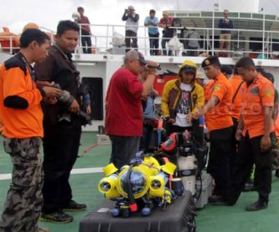Members of Indonesia's national search and rescue agency Basarnas on board the search vessel preparing to deploy their JW Fishers ROV. (Photo courtesy of JW Fishers)