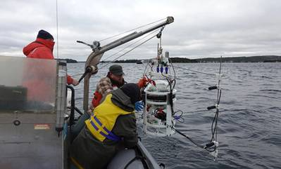 Members of Professor David Barclay's lab deploy an underwater acoustic reader. Copyright: David Barclay