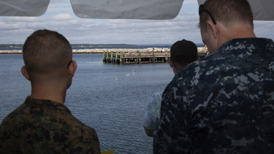 U.S. Military personnel reviewing the SwarmDiver system during the U.S. Navy's Advanced Naval Technology Exercise in August 2018.  (Photo: UUV Aquabotix)