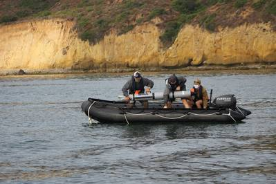 U.S. Navy personnel deploy a REMUS 300 unmanned underwater vehicle. Image courtesy HII