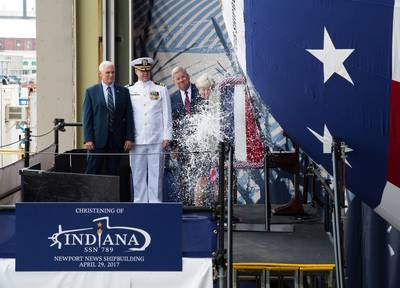 Ship's Sponsor Diane Donald christens the Virginia-class submarine Indiana (SSN 789), witnessed by (from left) Vice President Mike Pence, Indiana's  Commanding Officer, Cdr. Jesse Zimbauer and Newport News Shipbuilding President Matt Mulherin. (U.S. Navy photo courtesy Huntington Ingalls Industries by Ashley Major)