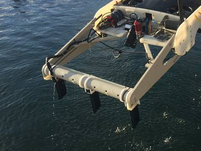 The Smartrak system deployed on the front of an AUV. The dark-colored Smartrak gradiometers can be seen mounted downwards on the white mounting frame. The sensors are fitted with fairings to reduce drag through the water. The AUV is flown close to the seabed during tasks. (Photo: INNOVATUM Ltd.)