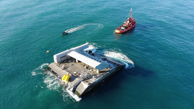 WaveRoller towed in to position off the coast at Peniche in Portugal. (Photo: AW-Energy)