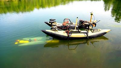 A yellow underwater robot (left) finds its way to a mobile docking station to recharge and upload data before continuing a task. (Purdue University photo/Jared Pike)