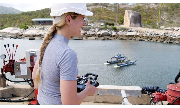 AIMS Technology Development Engineering Team Leader Melanie Olsen driving QUT's WAM-V at ReefWorks Marine Operations Test Range. (Photo: Australian Institute of Marine Science)