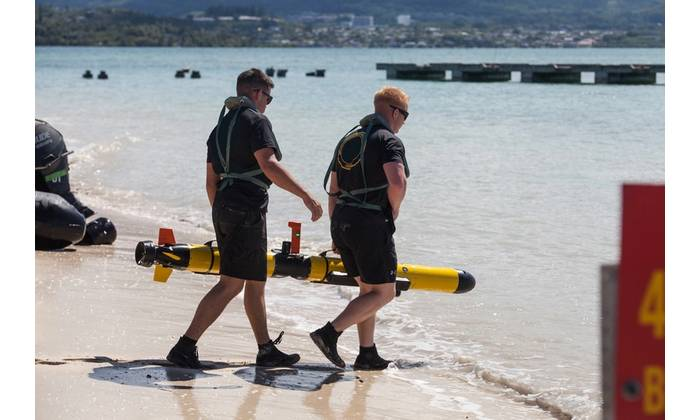 Marines test the future of oceanic reconnaissance at Marine Corps Base Hawaii using an Iver unmanned underwater vehicle (Marine Corp photo by Sgt. Jesus Sepulveda Torres.) The appearance of U.S. Department of Defense (DoD) Note: visual information does not imply or constitute DoD endorsement.