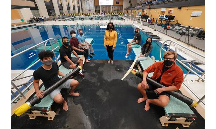Nina Mahmoudian (center) and her students have developed an underwater glider that can operate silently and in confined spaces, ideal for conducting biology or climate studies without disturbing wildlife. (Purdue University photo/Jared Pike)