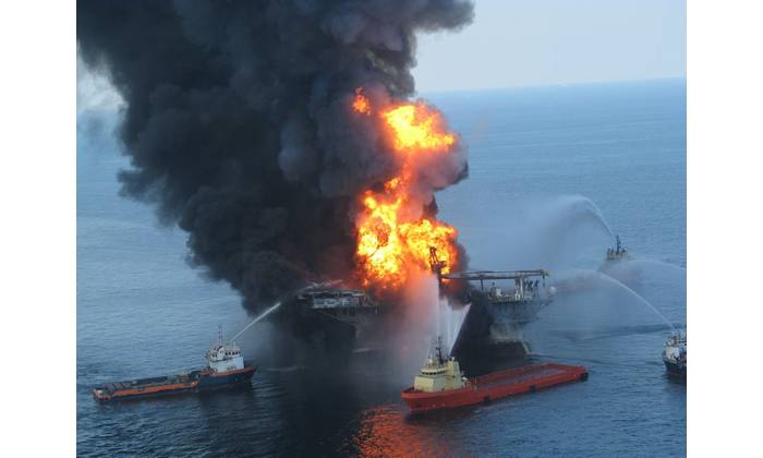 Response crews battle the blazing remnants of the off shore oil rig Deepwater Horizon April 21, 2010 (File photo: U.S. Coast Guard)