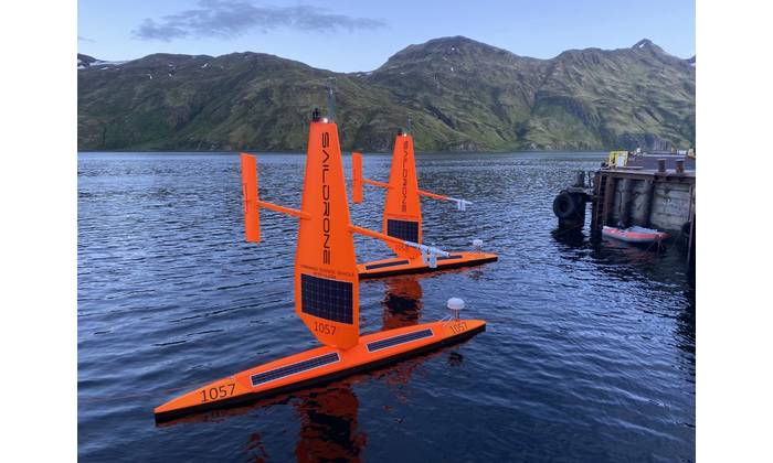 Two saildrones awaiting deployment from Dutch Harbor, AK. Credit: Courtesy of Saildrone