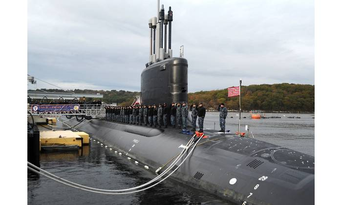 Sailors assigned to the Virginia-class attack submarine Pre-Commissioning Unit (PCU) Illinois (SSN 786) salute after bringing the ship to life during a rehearsal for the submarine's commissioning ceremony. Illinois is the U.S. Navy's 13th Virginia-Class attack submarine and the fourth U.S. Navy ship named for the state of Illinois. (U.S. Navy photo by Darryl I. Wood)