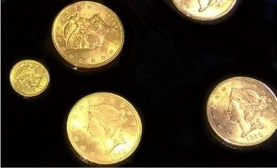 Coins recovered from the shipwreck of SS Central America (Photo: Odyssey Marine Exploration)