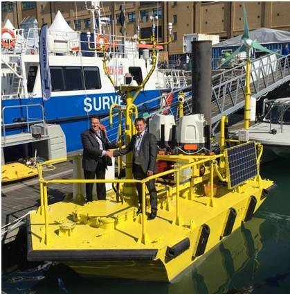 Terry Tarle, President & CEO of AXYS confirms deal with Ian Locker, MD of ZephIR LiDAR for the provision of dual ZephIR 300s on WindSentinel floating LiDAR buoy (Photo courtesy of AXYS Technologies Inc.)