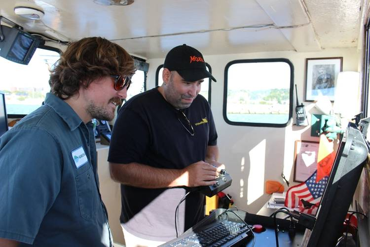 Andy Goldstein, VP Engineering, VideoRay, and Colin Riggs, Sr. Engineer, Greensea, review the final software integration for the Mission Specialist ROV. (Photo: Greensea)