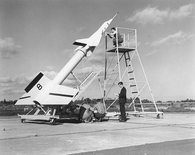 Avro technicians prepare an Avro Arrow test model attached to a Nike booster rocket to fire out over Lake Ontario at Point Petre in the 1950s (Image: Kraken)