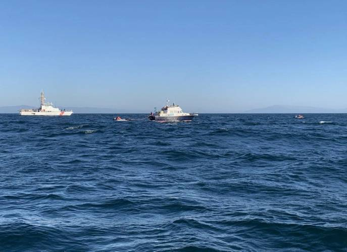 Coast Guard Cutter Hawksbill assists NOAA personnel with the disentanglement of a whale three miles southwest of Santa Cruz. (U.S. Coast Guard photo)